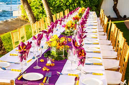 Maui wedding rentals included the bamboo chairs with matching bamboo utensils at this oceanfront wedding in Lahaina.