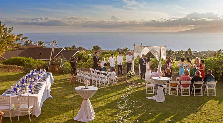 A complete Maui wedding package including the chuppa, officiate, wedding location and catered wedding reception with euro lighting.