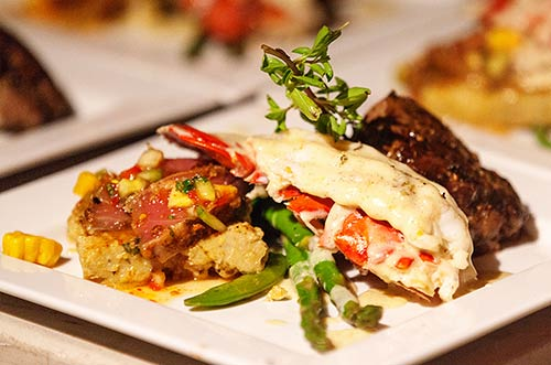 A Surf and Turf dinner for a catered Maui wedding reception with Ahi, Lobster and Filet Mignon Steak.