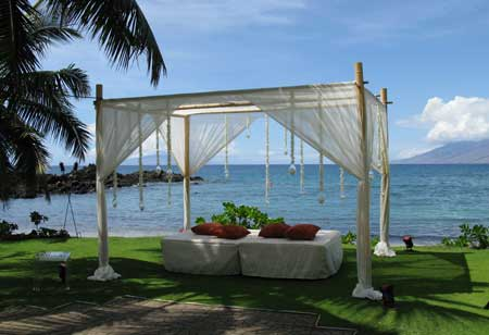 Maui wedding rentals include bamboo wedding chuppah for lounge after wedding ceremony.