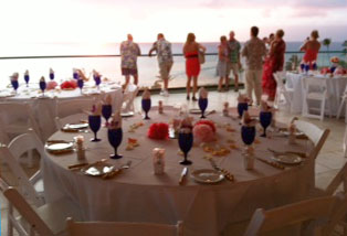 A catered Kaanapali wedding reception table setting at the Outrigger Cabana.